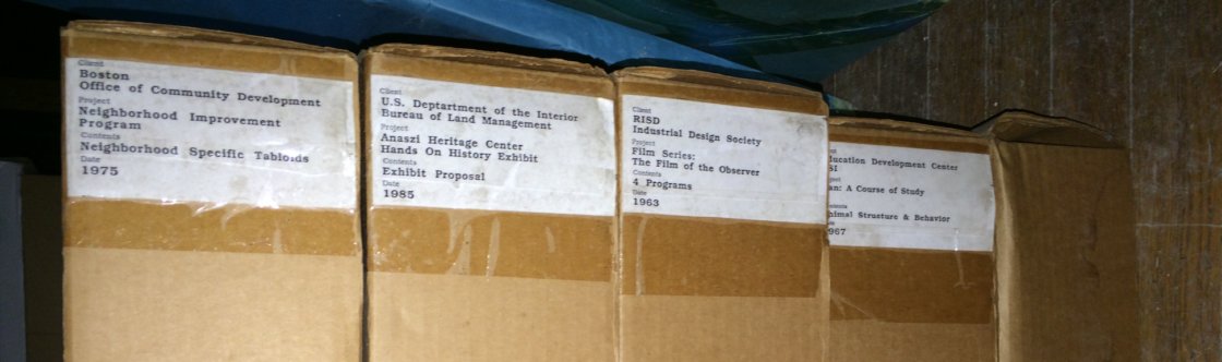 Five cardboard boxes, labeled by client and project.
